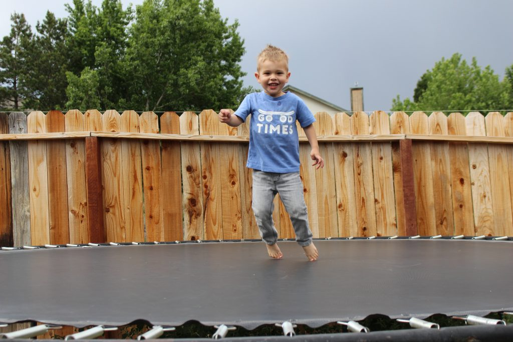 potty training boy on trampoline