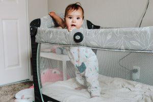 Beautiful baby girl in pack n play