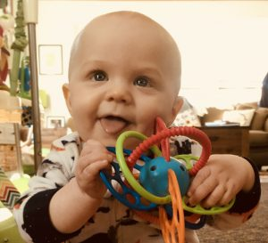Baby with teether toy