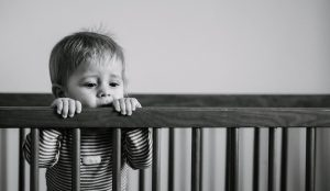 baby in crib grayscale