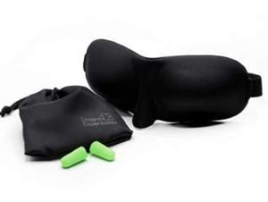 molded black eyeshades and green earplugs in pouch